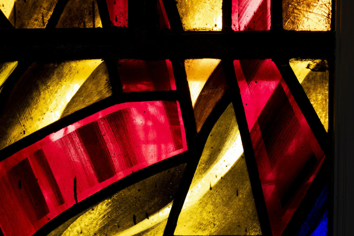 yellow, red and black stained glass
