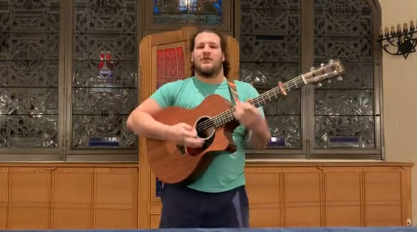 Michael Harlow playing guitar for pre-shabbat family jam